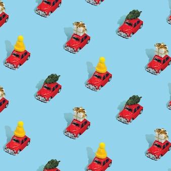 Modèle sans couture de noël fait avec des voitures rouges avec des cadeaux, des pins et des chapeaux sur bleu