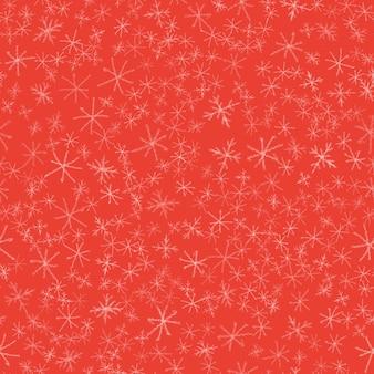 Modèle sans couture de noël de flocons de neige dessinés à la main. flocons de neige volants subtils sur fond de flocons de craie. belle superposition de neige dessinée à la main à la craie. décoration fantaisie des fêtes de fin d'année.