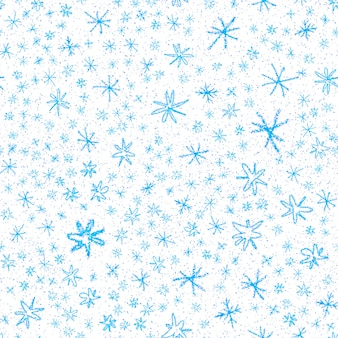 Modèle sans couture de noël de flocons de neige dessinés à la main. flocons de neige volants subtils sur fond de flocons de craie. superposition de neige dessinée à la main à la craie séduisante. décoration exceptionnelle des fêtes de fin d'année.