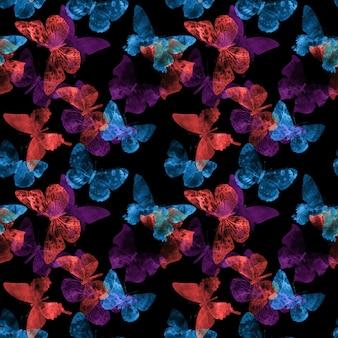 Modèle sans couture avec des papillons isolés sur fond noir. photo de haute qualité