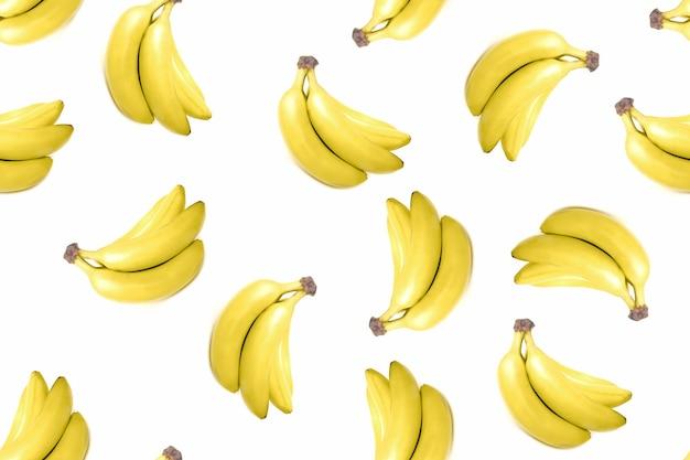 Modèle sans couture de tas de bananes sur fond isolé blanc