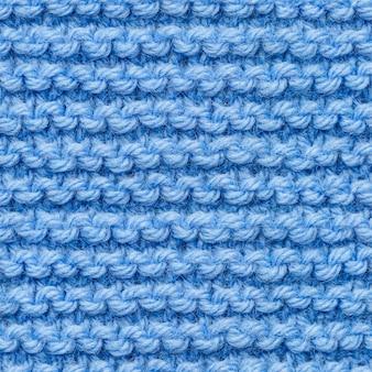 Modèle sans couture de tissu tricoté bleu