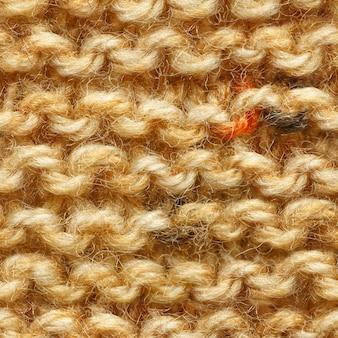 Modèle sans couture de tissu tricoté de couleur beige marron jaune