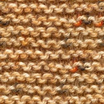 Modèle sans couture de tissu tricoté jaune marron
