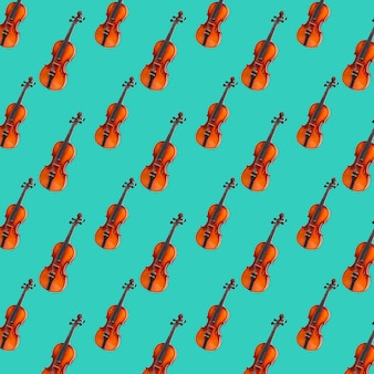 Modèle sans couture de violon sur fond vert pastel. impression de violon