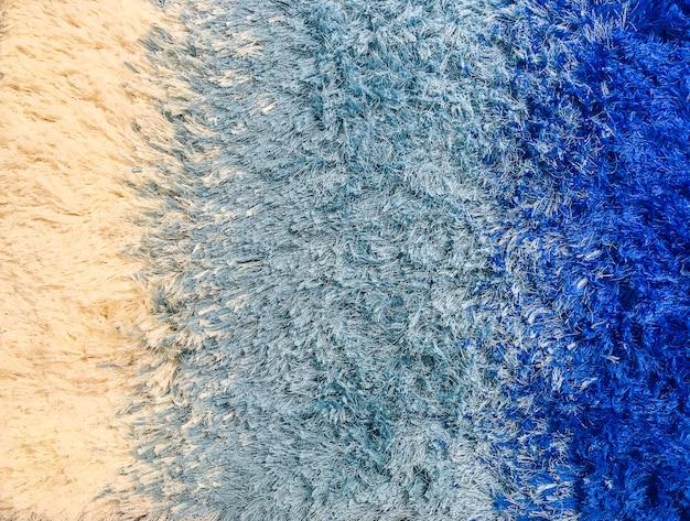 Modèle de tissu abstrait surface agrandi sur le tapis de tissu bleu à l'étage de la maison fond texturé