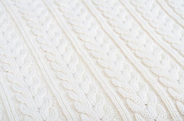 Modèle de tissu tricoté de fond avec des nattes
