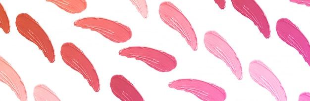 Modèle de traits de rouge à lèvres, frottis de maquillage isolé on white