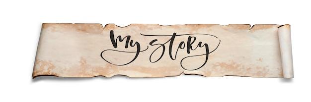 Mon histoire. inscription manuscrite sur un rouleau de vieux papier. isolé sur blanc.
