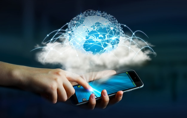 Monde numérique dans un nuage connecté à un téléphone portable de femme d'affaires