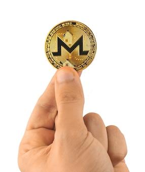 Monero cryptocurrency coin en main isolé sur fond blanc photo