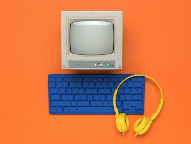 Un moniteur avec un clavier bleu et des écouteurs jaunes sur fond orange. mise à plat.