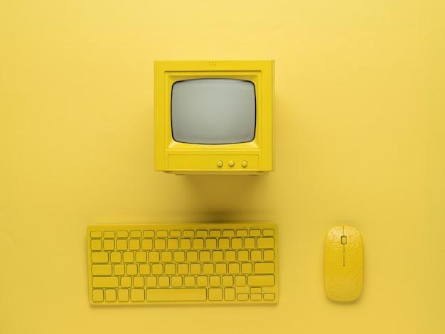 Moniteur, clavier et souris jaunes sur fond jaune vif. mise à plat.