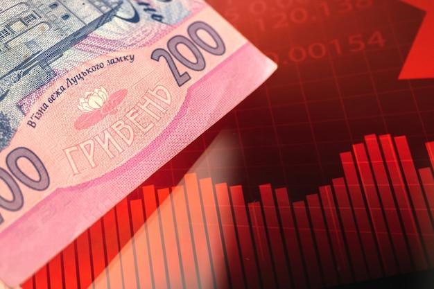 La monnaie ukrainienne est en train de tomber, effondrement de l'économie de l'arrière-plan du concept de pays avec graphique boursier rouge