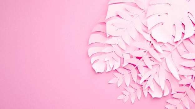 Monstera feuilles avec espace copie sur fond rose