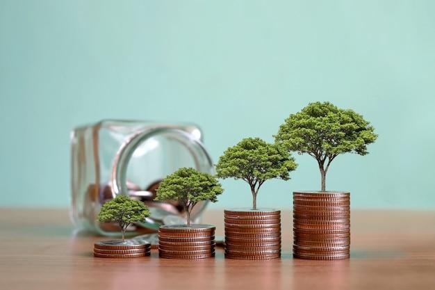 Montrez votre développement financier et la croissance de votre entreprise avec un arbre qui pousse à partir de pièces de monnaie