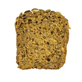 Un morceau de pain de farine de blé avec du son et des graines de citrouille, des graines de sésame et des noix