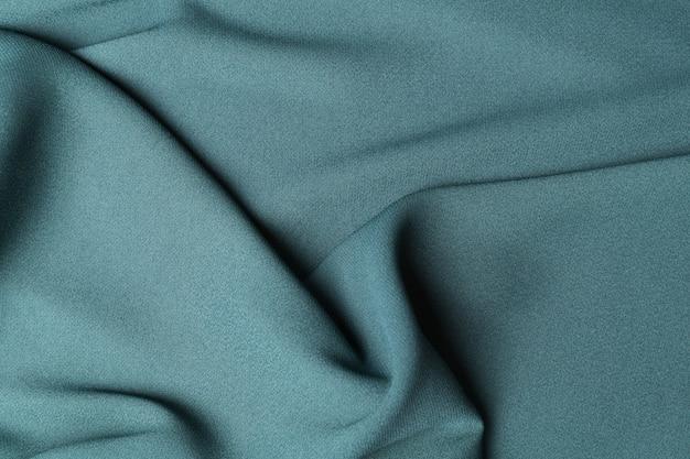 Morceau de tissu vert plié