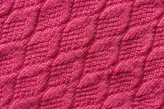 Morceau de tricot rose, fond ou texture. fil à tricoter fait main