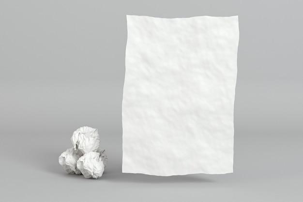 Morceaux de papier froissé et carte de visite