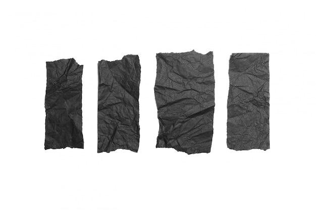 Des morceaux de papier noir