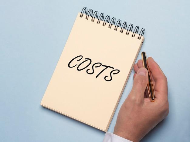 Mot de coûts, inscription. concept d'entreprise et d'argent.