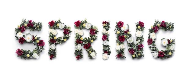 Mot du printemps fait de fleurs sur blanc