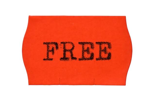 Mot gratuit imprimé avec une police de machine à écrire sur un autocollant rouge isolé sur fond blanc