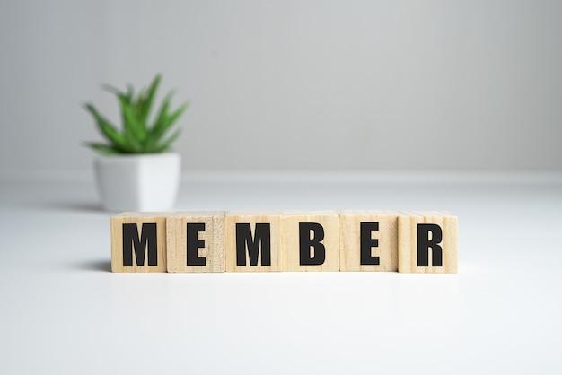 Mot des membres écrit sur bloc de bois. texte des membres sur une table en bois pour votre conception, concept.