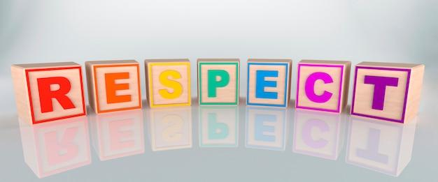 Mot de respect fait avec des cubes en bois, aux couleurs arc-en-ciel