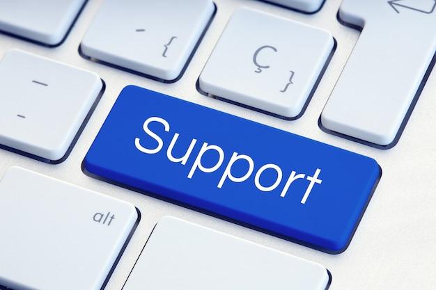 Mot de soutien sur la touche de clavier de l'ordinateur bleu