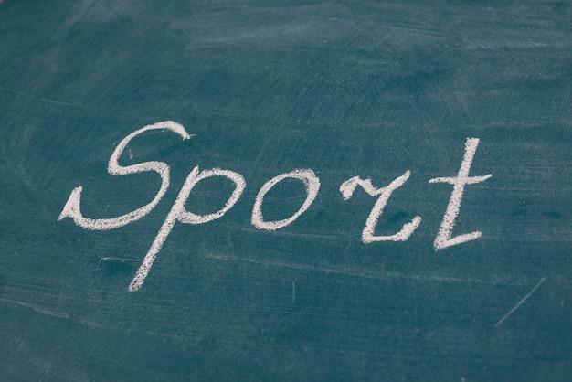 Mot de sport écrit à la main sur le tableau