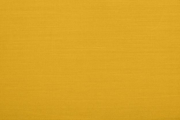 Motif abstrait en osier pour la coloration d'arrière-plan dans la couleur tendance fortuna gold de l'année 2021. vue macrophotographie détaillée en gros plan du matériau de décoration de texture, texture de fond moderne pour le design, art