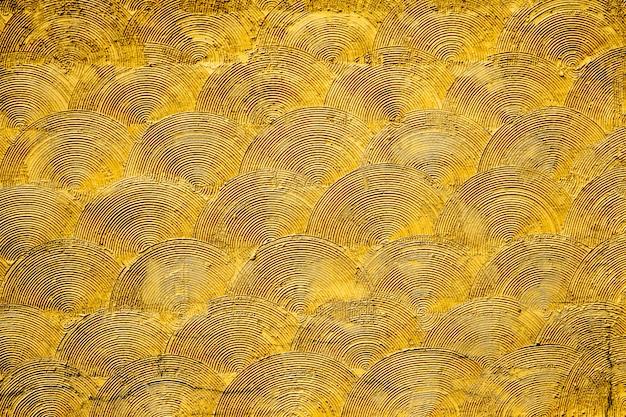 Motif d'art en or sur la surface du mur. utiliser pour décorer et l'intérieur