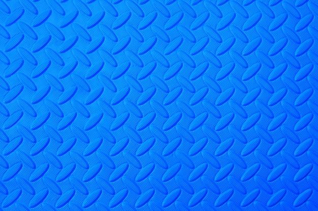 Motif de caoutchouc bleu, fond de texture de sol en plastique.