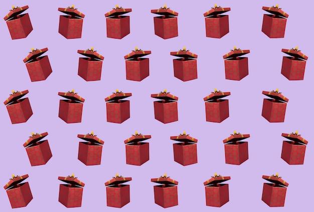 Un motif de coffrets cadeaux colorés présente une mise à plat. fond de célébration surprise