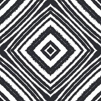 Motif dessiné à la main arabesque. fond de kaléidoscope symétrique noir. conception dessinée à la main arabesque orientale. prêt de textile imprimé envoûtant, tissu de maillot de bain, papier peint, emballage.
