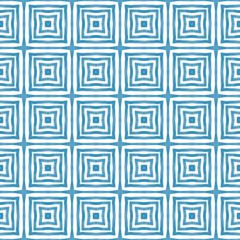 Motif dessiné à la main à rayures. fond bleu kaléidoscope symétrique. textile prêt à l'emploi, impression incroyable, tissu de maillot de bain, papier peint, emballage. répétition de carreaux dessinés à la main à rayures.