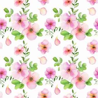 Motif floral sans couture avec aquarelles roses et feuilles vertes sur blanc.
