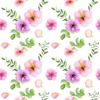 Motif floral sans couture avec des roses roses aquarelles et des feuilles vertes sur blanc.