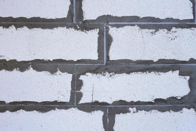Motif de fond de bloc de béton mousse