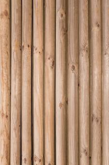 Motif de fond naturel d'un mur de rondins