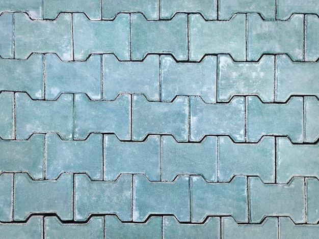 Motif de fond plein cadre de plancher de briques carrelées vertes