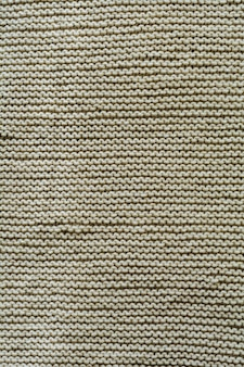 Motif de fond de texture laine tricotée beige