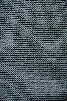 Motif de fond de texture de laine tricotée grise