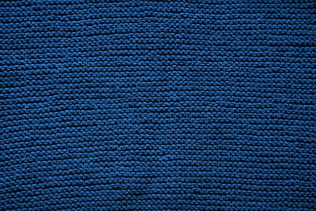 Motif de fond de texture de laine tricotée indigo bleu