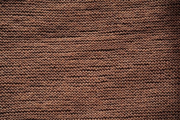 Motif de fond de texture de laine tricotée marron