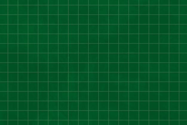 Motif de grille sur un fond texturé de papier vert foncé