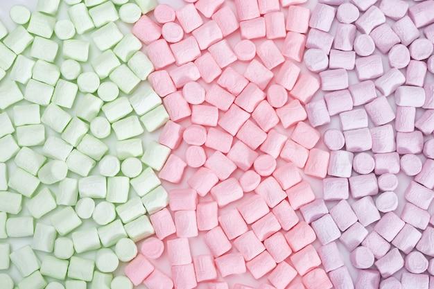 Motif de guimauves blanches, lilas et vertes.