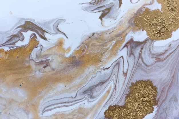 Motif d'ondulation blanc, or, cuivre et noir. texture abstraite en marbre avec des particules d'or.